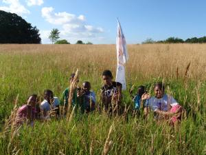 Summer Learning students with teamflag.
